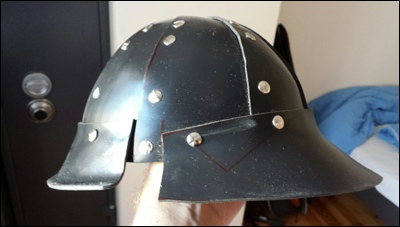 Bowl with visor and neck guard attached to it. It all looks pretty rough and edgy, still.