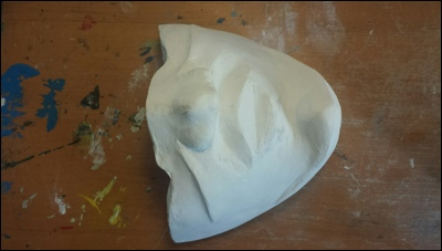 Plaster model of my face, meant to serve as basis for modeling the kydex mask.