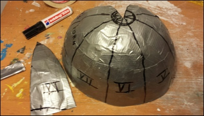 Duct Tape taken off the model. Cutting lines plotted onto it. Then I cut it in pieces.