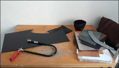 My limited work space (kitchen table) for making my kabuto with kydex