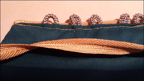 A beautiful golden lace was added to the edge of the sleeve, right behind the loops