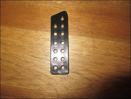 A single lamella. It shows 13 holes and in the end, a lace will go through each of these holes. A lot of work need to be done to get a full japanese armor / do in early 12th century samurai style.
